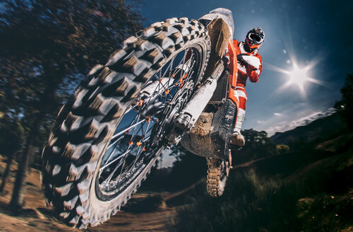 Motocross biker jumping - OCMF00109