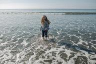Cheerful girl playing in sea - CAVF54205