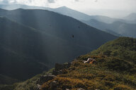 Bulgaria, Balkan Mountains, naked woman lying on the ground - AFVF01942