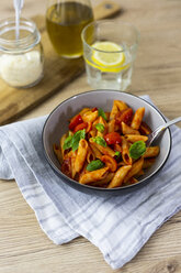 Penne with tomato and basil in bowl - GIOF04822