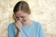 Portrait of laughing young woman - KNSF05343