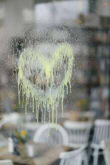 Dissolving heart on windowpane at a cafe - KNSF05382
