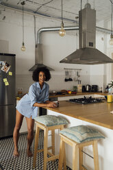 Woman standng in her kitchen, having her morning coffee - BOYF01066