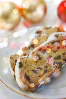 Slices of German Christmas stollen on a plate - JTF01140