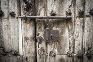 Close-up of latch on wooden door - CAVF54713