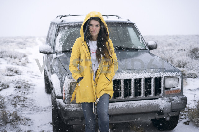 Portrait of woman standing by off-road vehicle on field during winter - CAVF54827 - Cavan Images/Westend61