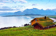 A hut overlooks the mountains in Fjord - INGF07545