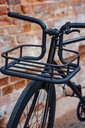 Cargo cage of acustomised commuter fixie bike at brick wall - VPIF01084