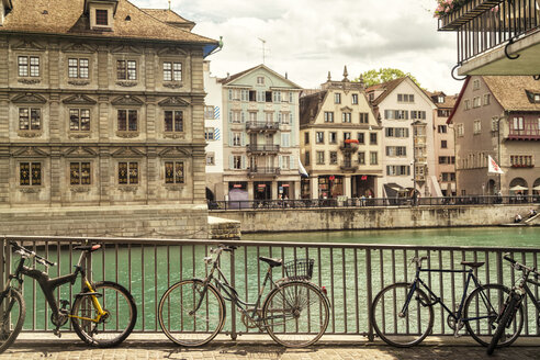 Cityscape with residential houses, river and bicycles, Zurich, Switzerland - AURF07747