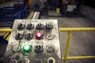 High angle view of buttons on messy control panel at metal industry - CAVF54966