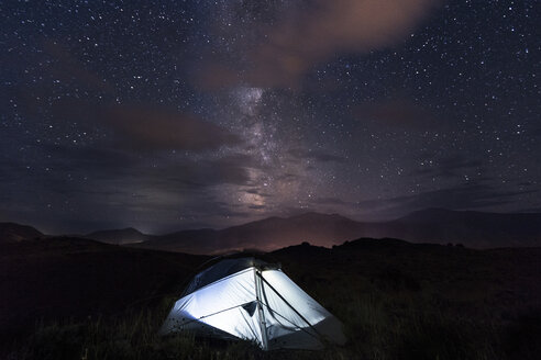 Illuminated tent on field against sky at night - CAVF55269
