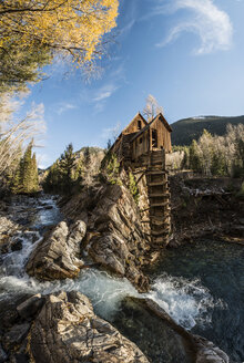 Scenic view of Crystal Mill by river against sky - CAVF55371