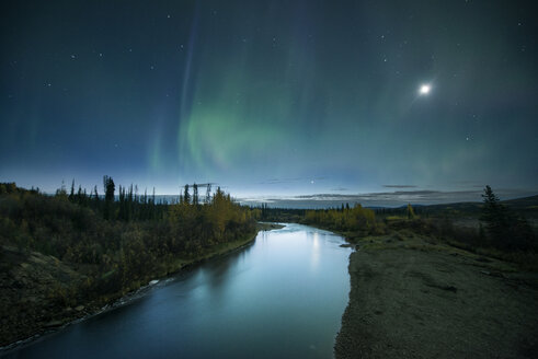 River amidst landscape against sky at night - CAVF55662
