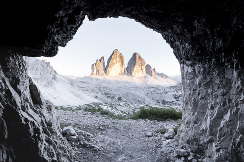 View of Tre Cime di Lavaredo seen through cave entrance - CAVF55824