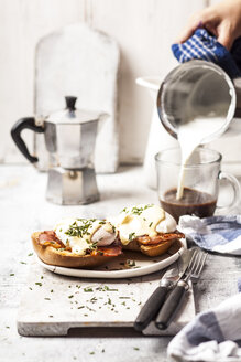 Traditional egg benedict with slices of bacon on toast,  poached egg and hollandaise - SBDF03824