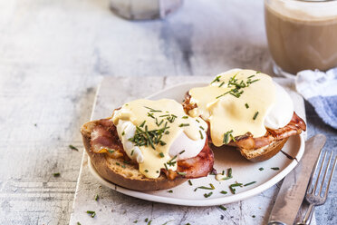 Traditional egg benedict with slices of bacon on toast,  poached egg and hollandaise - SBDF03827