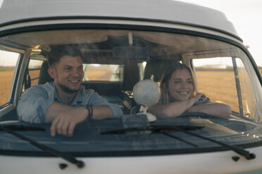 Happy young couple on a trip in camper van - GUSF01641