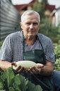 Gardener holding zucchini - VPIF01129