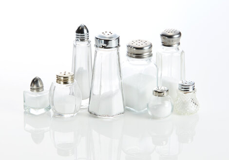 Eight various salt shakjers ageinst white background - KSWF01985