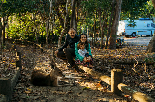 Australia, Queensland, Mackay, Cape Hillsborough National Park, happy familiy and kangaroo in the forest - GEMF02546