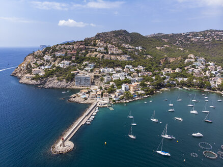 Spain, Balearic Islands, Mallorca, Andratx Region, Aerial view of Port d'Andratx, coast and natural harbour with lighthouse - AMF06239