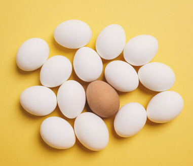 Overhead view of eggs on yellow background - CAVF55902