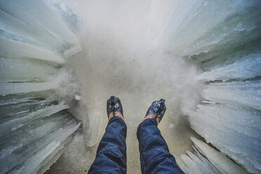 Low section of man standing in ice cave - CAVF55923