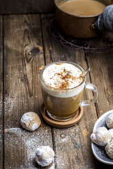 Pumpkin spice latte with a dollop of cream and some cookies - SBDF03836