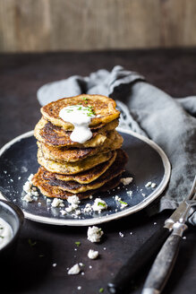 Stack of zucchini fritters with garlic yogurt sauce and feta - SBDF03860