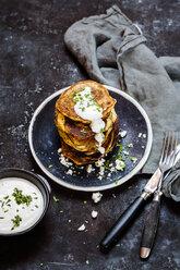 Stack of zucchini fritters with garlic yogurt sauce and feta - SBDF03863