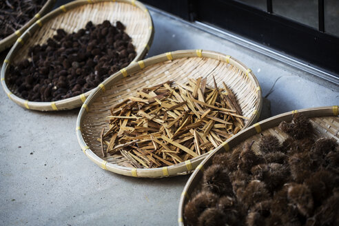 High angle close up of Yashabuji, Haze and Kuri Chestnut in a textile plant dye workshop. - MINF09609
