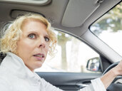 Portrait of mature woman driving car - LAF02167