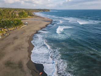 Indonesia, Bali, Aerial view of surfers at Balian beach - KNTF02349