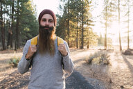 USA, North California, portrait of bearded man in a forest near Lassen Volcanic National Park - KKAF02977
