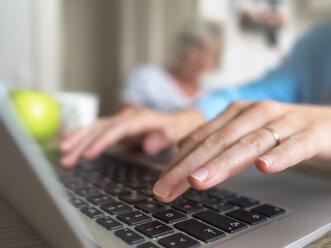 Hands on laptop keybard - LAF02182