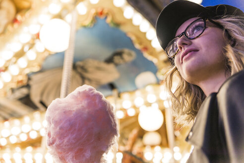 Teenage girl with pink candyfloss at fair - FBAF00169