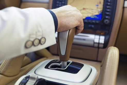 Hand of a businessman on the gearshift - JSRF00099