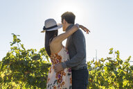 Italy, Tuscany, Siena, young couple embracing in a vineyard - FBAF00201