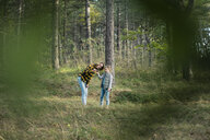 Mother and daughter exploring nature in the forest - MOEF01655