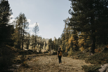 Switzerland, Engadin, woman on a hiking trip in forest - LHPF00130