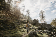 Switzerland, Engadin, woman on a hiking trip in the mountains - LHPF00136
