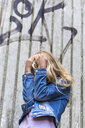 Blond girl hiding her face - JFEF00924