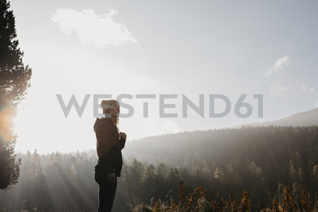 Switzerland, Engadin, woman on a hiking trip in mountain forest - LHPF00146 - letizia haessig photography/Westend61