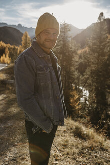 Mature man travelling through Switzerland, standing in nature - LHPF00182