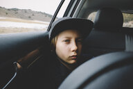 Portrait of boy wearing cap while traveling in car - CAVF56678