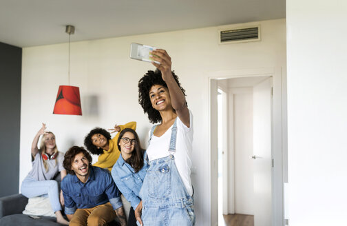 Cheerful friends taking a selfie at home - VABF01905