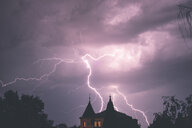 Lighting strikes in the sky during a thunderstorm - INGF07979