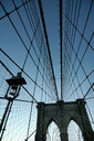 Low angle architectural view of Brooklyn bridge under a clear sky - INGF08009