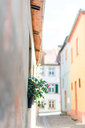 A narrow alley amidst houses in the day - INGF08030