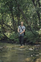 Young man fishing in a forest - VPIF01157
